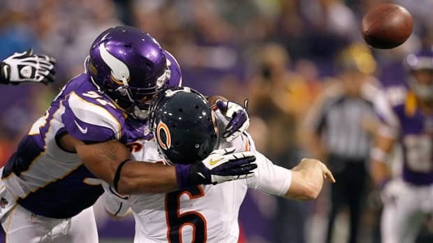 Chicago Bears quarterback Jay Cutler gets hit by Minnesota Vikings defensive end Everson Griffen after passing the ball during the second half of Sunday's game in Minneapolis.