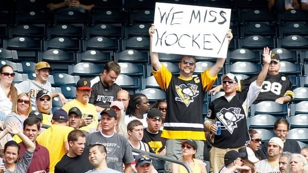 A Pittsburgh Penguins fan expresses himself during the game between the Pittsburgh Pirates and the Atlanta Braves on Oct. 3 in Pittsburgh.