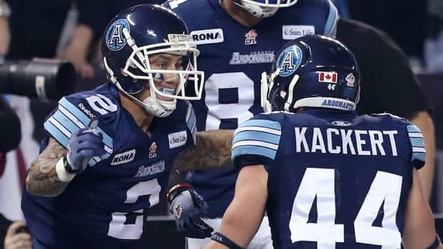 Toronto Argonauts slotback Chad Owens, left, celebrates with teammate Chad Kackert during the 2012 Grey Cup.