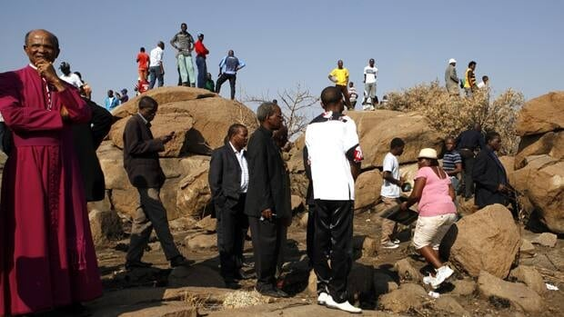 Church leaders visit the scene where miners were shot and killed at the Lonmin mine near Rustenburg.