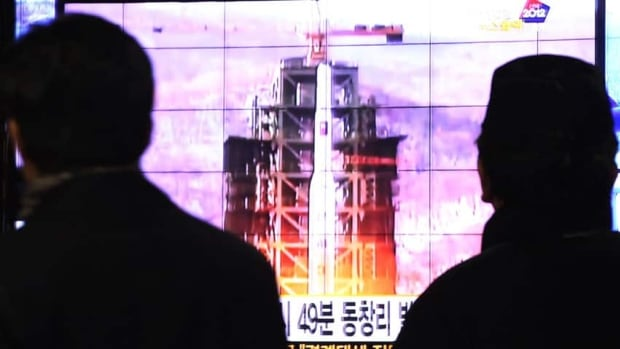 South Koreans in Seoul watch TV news reporting Wednesday's launch of the Unha rocket from Tongchang-ri, North Korea.