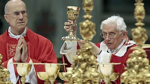 Pope Benedict offers mass in May 2012, flanked by Cardinal Tardisio Bertone, one of the central figures in the Vatileaks story.