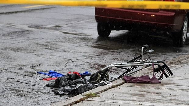 A crumpled walker and some clothing could be seen on the ground behind police tape on Govenors Road in Dundas on Sunday.