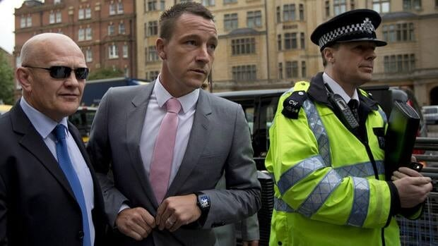 Former England soccer captain and current Chelsea player John Terry, centre, arrives at Westminster Magistrates Court in London, Monday for his racism trial.
