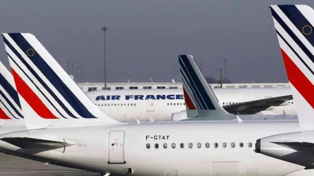 Initial information indicates the body found in a western suburb of Niger's capital was that of a stowaway who fell from the landing gear, an Air France spokesman says.