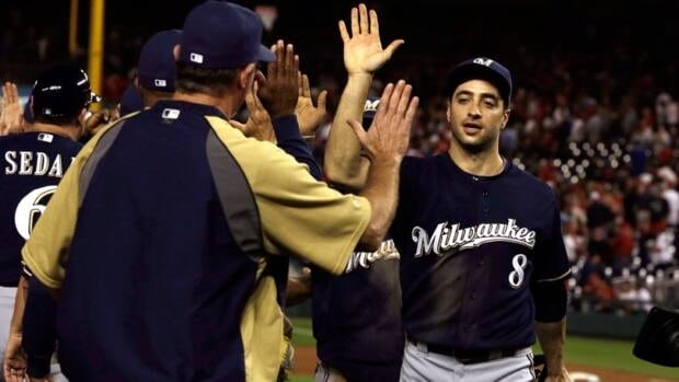 Milwaukee Brewers outfielder Ryan Braun, right, is one of five finalists for the 2012 National League MVP award. Braun received the honour in 2011.