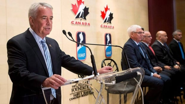 Hockey Canada President and CEO Bob Nicholson, seen here speaking about changes to the Hockey Canada program in June, says that Team Canada may not have a pre-Olympics training camp due to the cost of insuring NHL players.