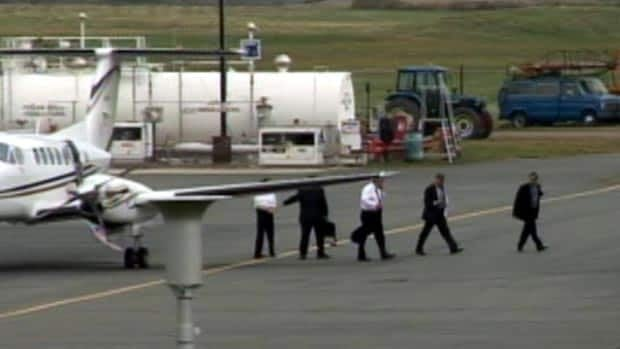 The Alward government has been criticized for its use of the government-owned airplane. David Alward, in this image, is leaving the plane in Charlo on Sept. 20, 2011.