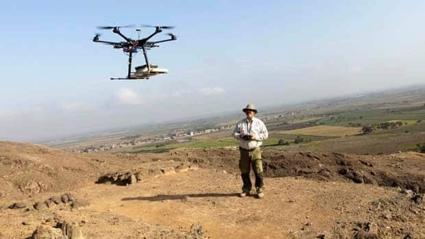 Luis Jaime Castillo, a Peruvian archaeologist, flies a drone over the archaeological site of Cerro Chepen,