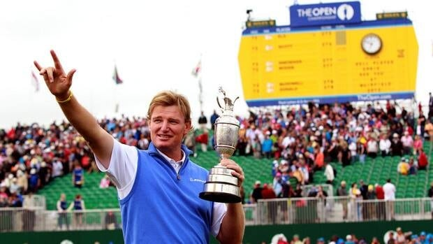 Ernie Els of South Africa holds the Claret Jug in front of the scoreboard on the 18th green after winning the 2012 British Open Golf Championship at Royal Lytham and St Annes in Lytham, England on Sunday.
