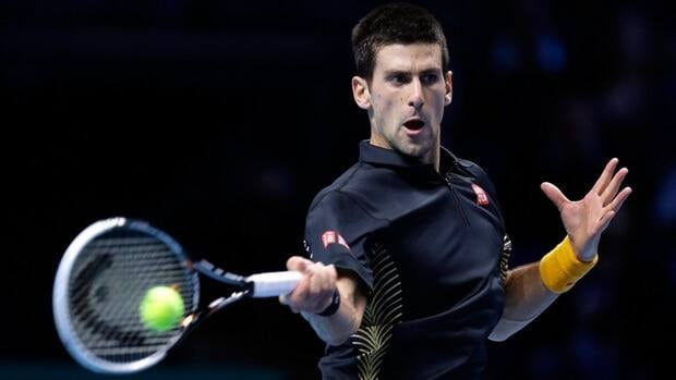 Novak Djokovic of Serbia plays a return to Juan Martin Del Potro of Argentina, during their ATP World Tour Finals singles semifinal in London, Sunday.