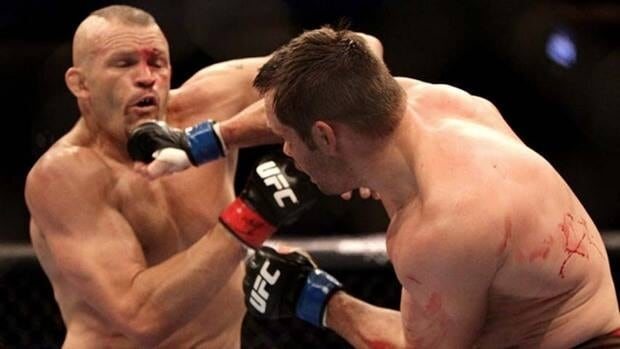 Rich Franklin, right, hits Chuck Liddell during a UFC match in Vancouver.