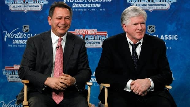 Detroit Red Wings general manager Ken Holland, left, and Toronto Maple Leafs President & General Manager Brian Burke at a news conference to announce the NHL Winter Classic.