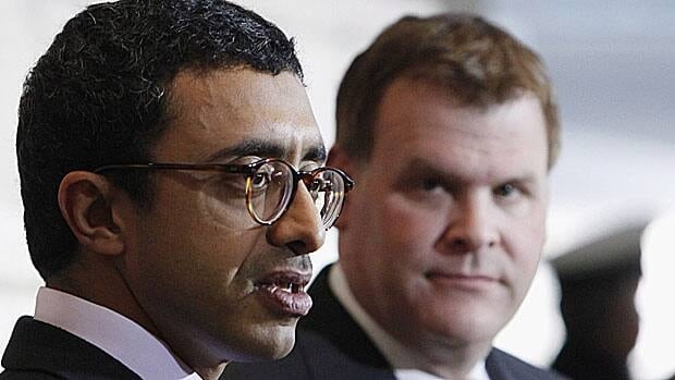 United Arab Emirates Foreign Minister Sheikh Abdullah bin Zayed Al Nahyan, left, and Foreign Affairs Minister John Baird take questions from reporters after talks in Ottawa on Monday.