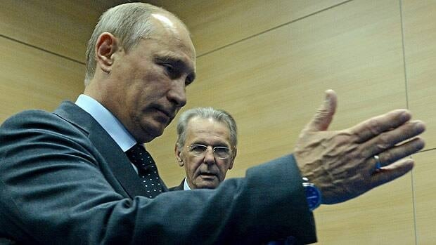 Russia's President Vladimir Putin, left, gestures during a meeting with IOC President Jacques Rogge at the SportAccord International Convention in St. Petersburg on Thursday.