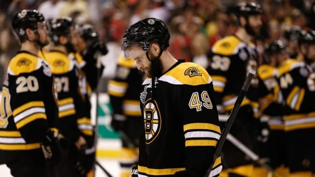 Boston Bruins' Rich Peverley hangs his head after his team was defeated by the Chicago Blackhawks in Game 6 of the Stanley Cup final in on Monday.