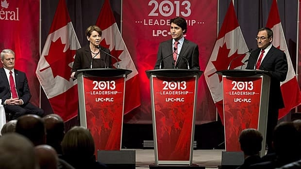 A new poll by Nanos Research shows the Liberals ahead of the Conservatives and NDP. The Liberal Party will announce Sunday who won the vote to become the next leader. Marc Garneau, who dropped out of the race, looks on as hopefuls Martha Hall Findlay, Justin Trudeau and Martin Cauchon take part in a debate in Halifax on March 3.
