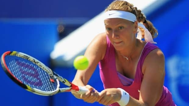 Petra Kvitova hits a backhand return in Tuesday's 7-5, 6-4 setback at Eastbourne, England.