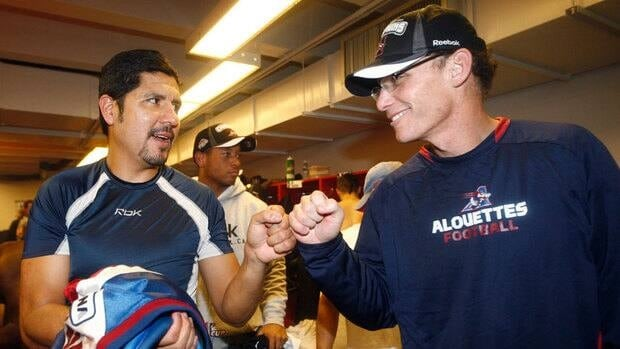 Marc Trestman, right, seen celebrating the 2009 Grey Cup win with quarterback Anthony Calvillo, spent nearly two decades in the NFL before arriving in Montreal.