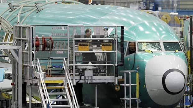 Workers assemble a Boeing 737. The U.S. economy capped off its strongest three-month showing since early 2010 last month by adding 227,000 jobs.