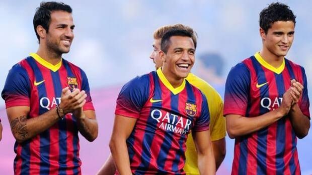 Ibrahim Afellay, far right, Cesc Fabregas, Alexis Sanchez are introduced at Camp Nou on Aug. 2.