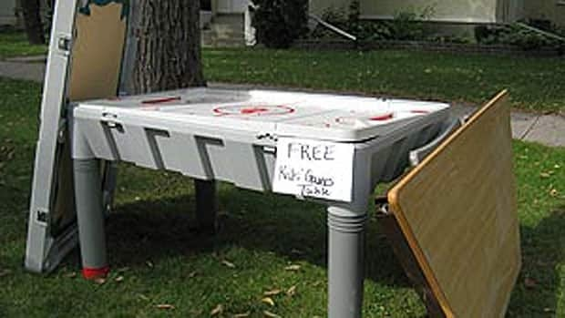 A table-top hockey game was up for grabs in one Winnipeg front yard at the first giveaway weekend in 2009.