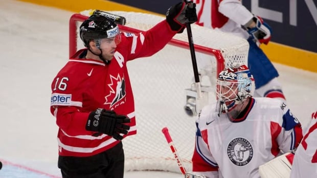 Team Canada Andrew Ladd celebrates his team's first goal past Norway goalie Lars Volden during the first period on Tuesday in Stockholm, Sweden.