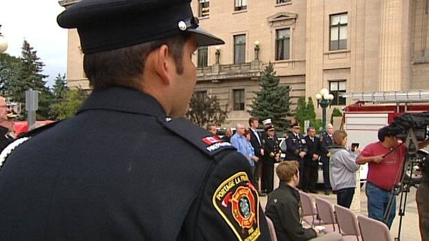 Police officers and firefighters from districts around the province gathered on the Manitoba legislature grounds Tuesday for the announcement about the memorial.