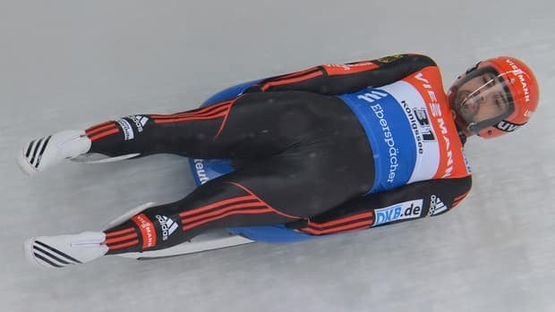 Andi Langenhan from Germany speeds down the course during his first run Koenigssee on Sunday. Langenhan lead a German sweep of the podium.