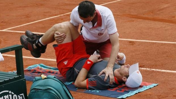 Andy Murray receives treatment for back spasms in a match at Roland Garros on Thursday.