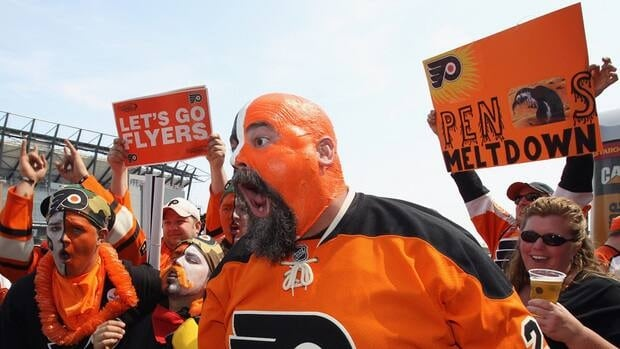Philadelphia Flyers fans party outside the arena prior to playing the Pittsburgh Penguins in Game 3 on Sunday in Philadelphia.