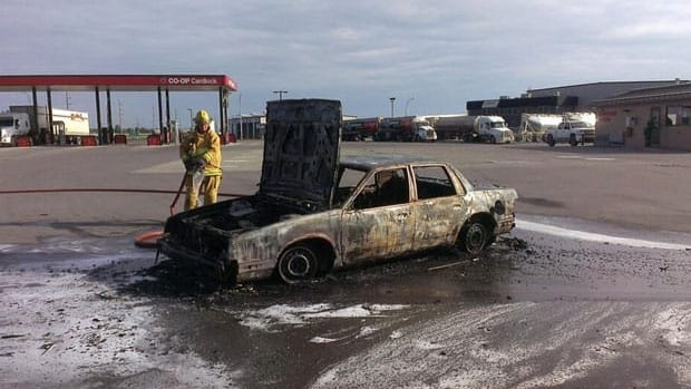 Fire crews doused a car that caught fire at a card-lock fuel station Tuesday.
