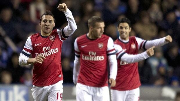 Arsenal's Spanish midfielder Santi Cazorla, left, celebrates scoring against Reading during the English Premier League football match at Madejski Stadium in Reading on Monday.