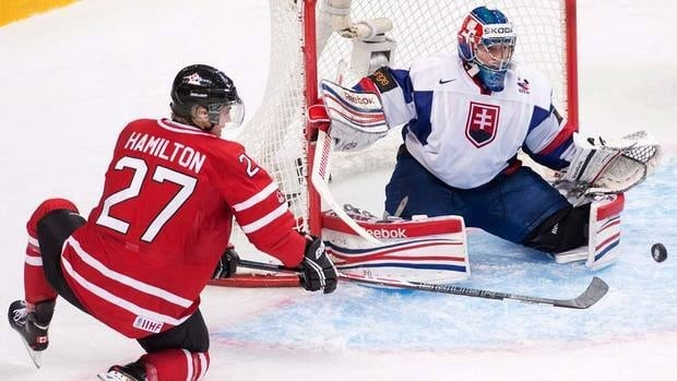 Canada defenceman Dougie Hamilton, left, is stopped by Slovakia goalie Adam Nagy during first period IIHF World Junior Championships hockey action in Ufa on Friday. Canada stormed back to win the contest.