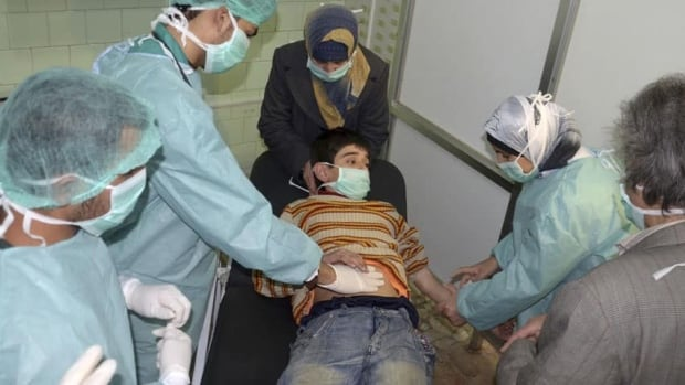A boy, affected in what the government said was a chemical weapons attack, is treated at a hospital in the Syrian city of Aleppo March 19, 2013. Syria's government and opposition have accused each other of firing a rocket loaded with chemical agents outside the northern city of Aleppo.