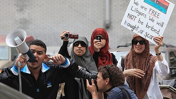 Anti-Gadhafi protesters demonstrate across the street from the Libyan Embassy in Ottawa, May 13, 2011. Three Libyan diplomats ordered out of Canada in 2011 later claimed refugee status, CBC News has learned.