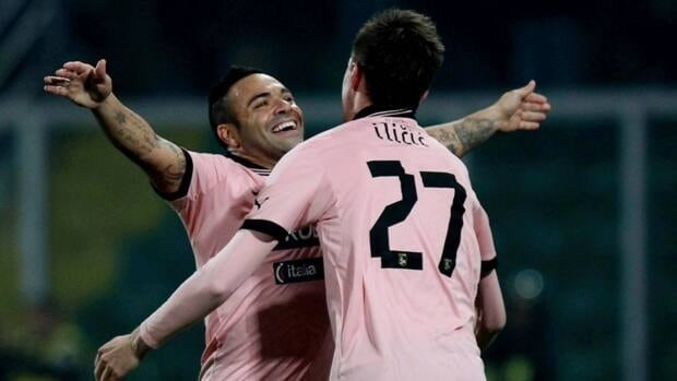 Palermo's Fabrizio Miccoli, left, and Josip Ilicic, right, celebrate a goal in Palermo, Italy, Saturday, Nov. 24, 2012. Miccoli scored the first goal and Ilicic pumped in two more for Palermo's 3 - 1 victory over Catania.