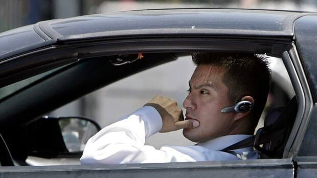 Using hand-held cellphones while driving is banned under provincial and territorial laws across Canada, but using hands-free devices is still allowed.