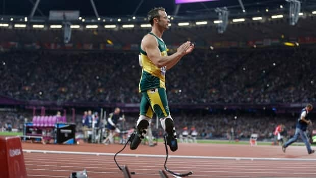South Africa's Oscar Pistorius applauds Britain's Jonnie Peacock, not seen, after he won the men's 10-metre T44 final at the 2012 Paralympics on Thursday.