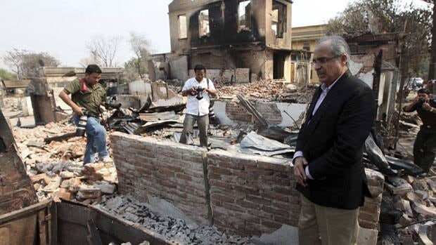 Vijay Nambiar, UN Secretary General Ban Ki-moon's special adviser on Burma, looks at debris of the buildings destroyed during the ethnic unrest. March 24, 2013.