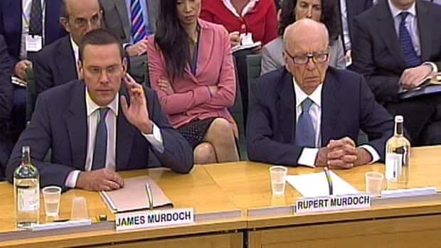 James Murdoch, left, and Rupert Murdoch, give evidence to the Culture, Media and Sport Select Committee on the News of the World phone-hacking scandal on July 19.