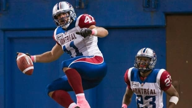 Montreal Alouettes Shea Emry, left, celebrates his touch down as teammate Seth Williams, right, watches against the Toronto Argonauts at Rogers Centre on Sunday, Oct. 14, 2012.