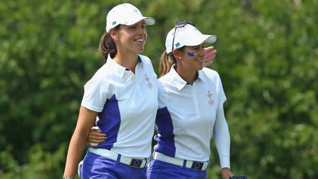 Karine Icher of France and Azahara Munoz of Spain during the friday foursomes matches at 2013 Solheim Cup at the Colorada Golf Club on August 16, 2013 in Parker, Colorado.