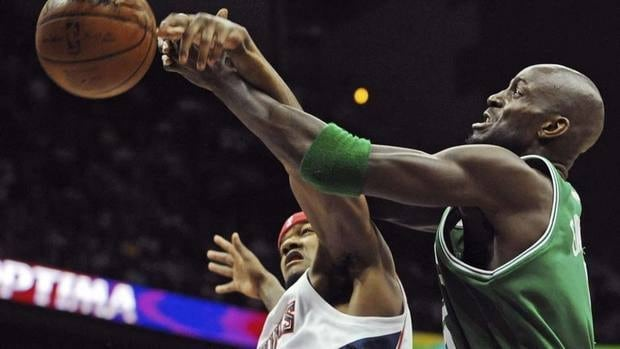 Atlanta Hawks forward Josh Smith, left, and Boston Celtics forward Kevin Garnett, right, have been going at it a long time now, such as here in the 2008 playoffs. They are still key cogs as they clubs meet again.