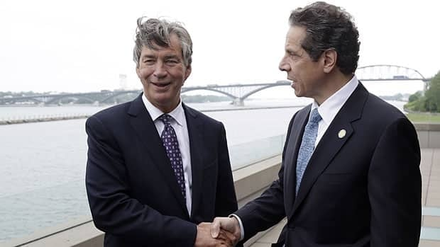 Canada's Ambassador to the United States Gary Doer, left, shakes hands with New York Gov. Andrew Cuomo after announcing a deal on the Peace Bridge in Buffalo, N.Y.