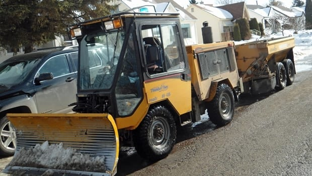This Thunder Bay sidewalk plow comes equipped with a sanding machine to help give pedestrians some extra traction.