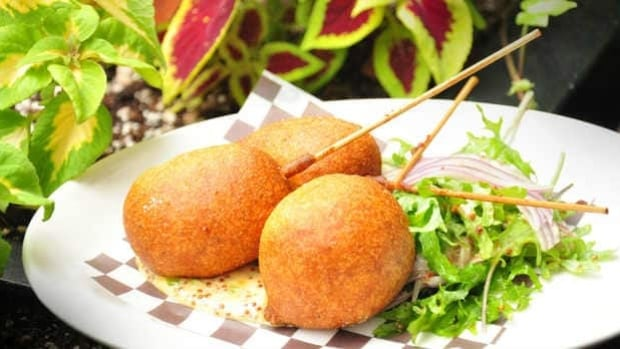 A handful of Vancouver restaurants are serving upscale and unconventional corn dogs, like this lobster dog served with spicy honey mustard by Society Dining Lounge.