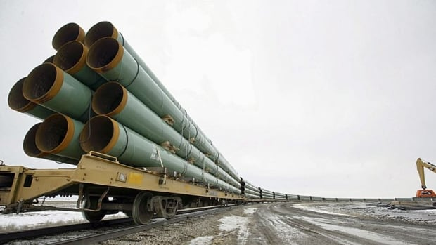 Rail cars arrive in Milton, N.D., loaded with pipe for TransCanada's Keystone XL pipeline. The company applied for a presidential permit for the project Friday.