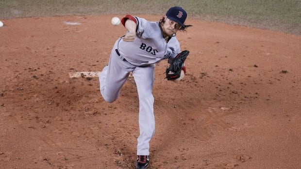 Clay Buchholz of the Boston Red Sox gave up two hits, three walks and no runs in Wednesday's victory over the Toronto Blue Jays.