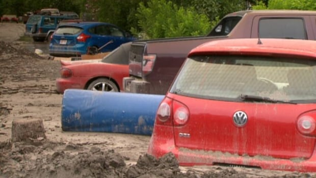 An estimated 10,000 vehicles were damaged during the June floods in Alberta.